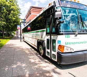 Happy passenger disembarking a Westmoreland Transit bus.