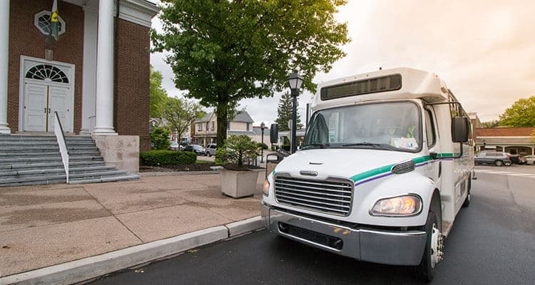 Westmoreland Transit bus stopped at a courthouse.
