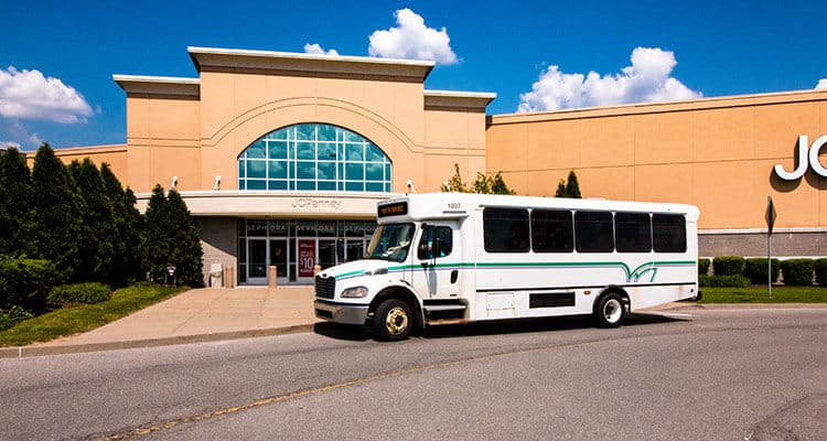 Westmoreland Transit bus stopped at JC Penney on route 14J.