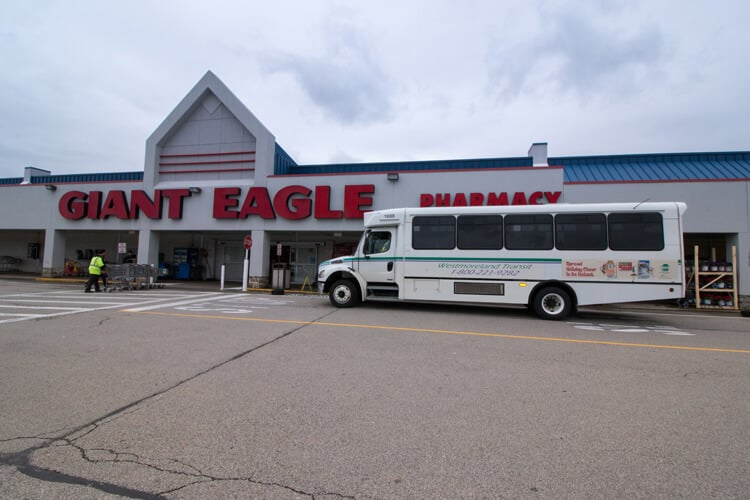 Westmoreland Transit bus stopped at a Giant Eagle grocery store.