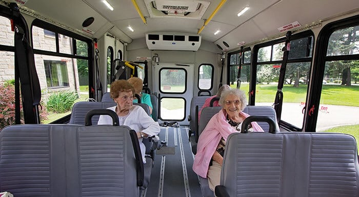 Happy seniors on a GO Westmoreland bus.
